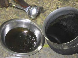 The impurities are scorched off (see edges of the pot), and the warm oil is decanted to a clean bowl and cooled. We would like to see the oil filtered through a clean cloth at this stage.